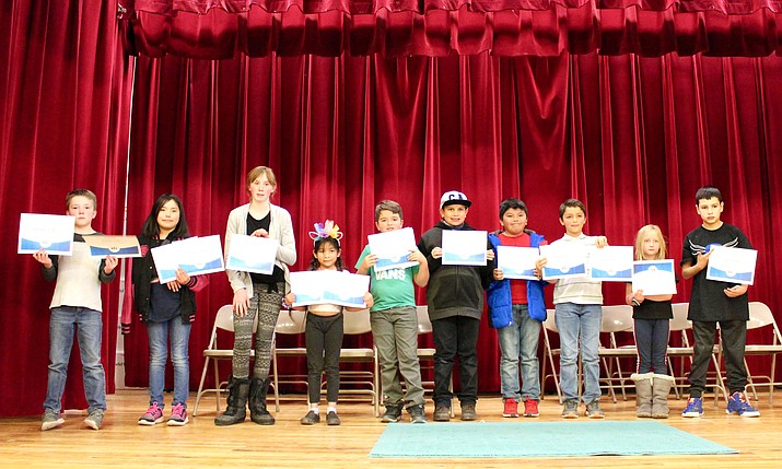Spelling bee competitors line up, proudly holding their certificates Jan. 15. (Photos/Ellie Pearce and Makayla Sanderson)