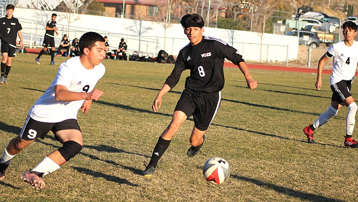 Lee Williams junior Jose Urtiz (8) goes after a loose ball Wednesday during a 3-0 loss to Coconino. (Photo by Beau Bearden/Kingman Miner)