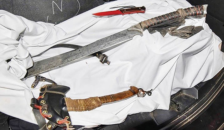 The Sedona Police Department released this photo Wednesday afternoon of weapons they say were in the possession of Jonathan David Messare, 41, when he was killed in an officer-involved shooting Tuesday. Courtesy of Sedona Police Department