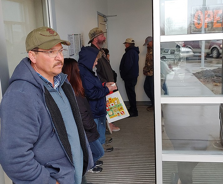 Coyote Springs resident Sergio Martinez waits in line at the Prescott Valley Post Office Annex, 6545 E. Second St., on a cold and drizzly winter day Jan. 21, 2020, to pick up his mail. Mail delivery to Coyote Springs has been postponed until roadwork is complete and a set of new cluster mailboxes is installed in the neighborhood off of Coyote Springs Road near Highway 89A. (Doug Cook/Courier)