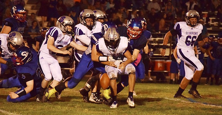 Camp Verde forces a Sedona Red Rock fumble during the Cowboys' 22-8 win over the Scorpions on Sept. 27. The CV/Sedona Red Rock football rivalry survived as the Scorpions' appeal to move to 1A and 8-man football was rejected. VVN/James Kelley