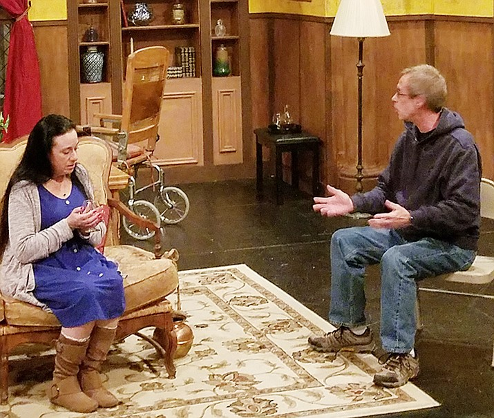 """Liz Rogers and Ron Lunt on set during a rehearsal for Prescott Center for the Arts' production of Agatha Christie's """"The Unexpected Guest."""" (Bill Osborne/Courtesy)"""