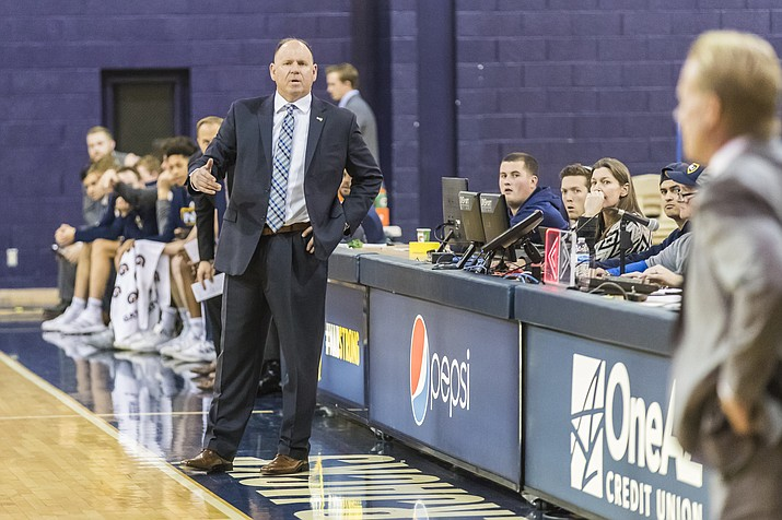 NAU men's basketball head coach Shane Burcar appeals to a call on the sideline in a game during the 2019-20 season. (Rick Johnson/NAU Athletics)