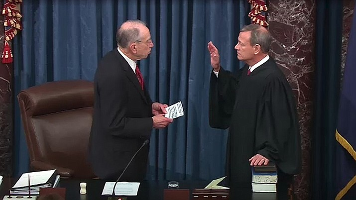 U.S. Sen. Chuck Grassley (R-Iowa) administers the oath of office to U.S. Supreme Court Chief Justice John Roberts in the opening of the impeachment trial of President Donald Trump. The Supreme Court heard arguments this week about religious education funding. (U.S. Senate photo/public domain)