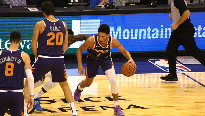 Devin Booker scored 35 points before fouling out Friday night as the Suns held on to beat the Spurs 103-99. (Miner file photo)