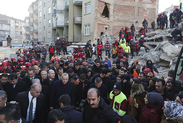 Turkey's President Recep Tayyip Erdogan, centre left, visits Elazig, eastern Turkey, site of Friday's earthquake, Saturday, Jan. 25, 2020. Rescuers continued searching for people buried under the rubble of collapsed buildings while emergency workers and security forces distributed tents, beds and blankets in the affected areas. Mosques, schools, sports halls and student dormitories were opened for hundreds who left their homes after the quake. (Presidential Press Service via AP, Pool)