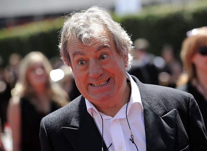 """FILE - In this Saturday, Aug. 21, 2010 file photo, Terry Jones arrives at the Creative Arts Emmy Awards in Los Angeles. Terry Jones, a member of the Monty Python comedy troupe, has died at 77. Jones's agent says he died Tuesday Jan. 21, 2020. In a statement, his family said he died """"after a long, extremely brave but always good humored battle with a rare form of dementia, FTD."""" (AP Photo/Chris Pizzello, file)"""