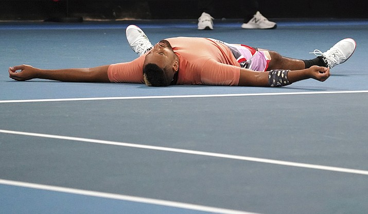 Australia's Nick Kyrgios lies on the court as he celebrates after defeating Russia's Karen Khachanov in their third round singles match at the Australian Open in Melbourne, Australia, Saturday, Jan. 25, 2020. (Lee Jin-man/AP)