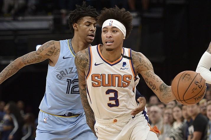 Phoenix Suns forward Kelly Oubre Jr. (3) handles the ball ahead of Memphis Grizzlies guard Ja Morant (12) in the second half of an NBA basketball game Sunday, Jan. 26, 2020, in Memphis, Tenn. (AP Photo/Brandon Dill)