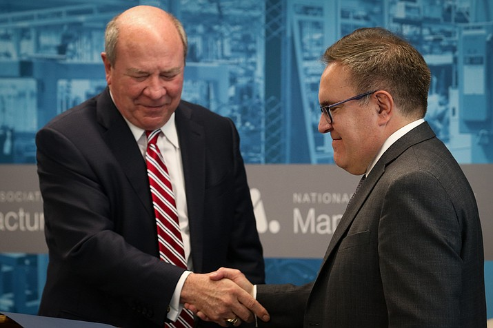 In this September photo, Army Assistant Secretary for Civil Works R.D. James, left, and Environmental Protection Agency Administrator Andrew Wheeler shake hands after signing the repeal of the Water of the United States rule. They unveiled a replacement Thursday. (Kailey Broussard/Cronkite News)
