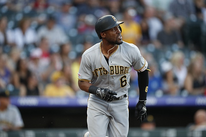 In this Aug. 31, 2019 photo Pittsburgh Pirates center fielder Starling Marte (6) in the first inning of a baseball game in Denver. Marte is heading to the Arizona Diamondbacks. The Pirates sent the two-time Gold Glove outfielder and 2016 All-Star to the Diamondbacks for prospects Liover Peguero and Brennan Malone, Monday, Jan. 27, 2020. (David Zalubowski/AP, file)