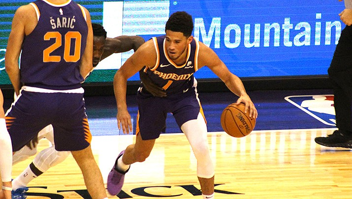 Devin Booker, right, scored 36 points but it wasn't enough to keep the Phoenix Suns from dropping a 114-109 decision to the Memphis Grizzlies on Sunday, Jan. 26 in Memphis. (Miner file photo)