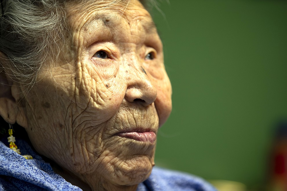 In this Monday, Jan. 20, 2020 image, Lizzie Chimiugak looks on at her home in Toksook Bay, Alaska. Chimiugak, who turned 90 years old on Monday, is scheduled to be the first person counted in the 2020 U.S. Census on Tuesday. (AP Photo/Gregory Bull)