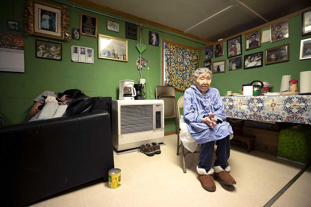 In this Monday, Jan. 20, 2020 image, Lizzie Chimiugak, right, looks on at her home in Toksook Bay, Alaska. Chimiugak, who turned 90 years old on Monday, is scheduled to be the first person counted in the 2020 U.S. Census on Tuesday. (AP Photo/Gregory Bull)