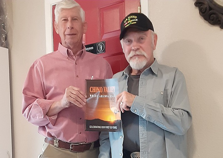 "Mike Best, left, stands with Wil Williams as they hold a mock up of the cover for ""Chino Valley: Where Arizona Began."" (Jason Wheeler/Review)"