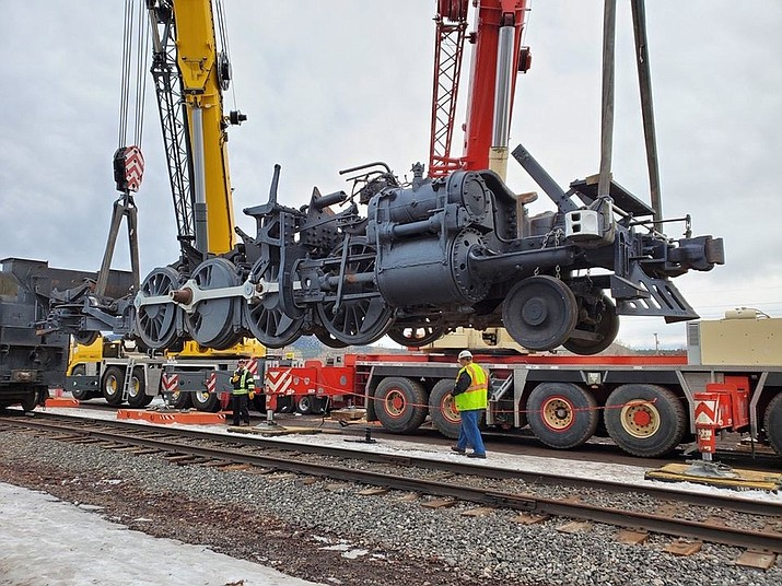 Workers load parts of Grand Canyon Railway's SP&S 539 steam locomotive on to railcars Jan 20. The locomotive was sold to the Port of Kalama recently. (courtesy of Port of Kalama)