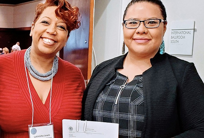 Latinisha Lewis (left) grant team lead at the U.S. Dept. of Justice, stands next to Velveena Davis, executive director of institutional planning and reporting at Diné College, at a recent meeting in Atlanta. Lewis presented Davis with a grant award pertaining to domestic violence, assault and stalking. (Photo/ Diné College)