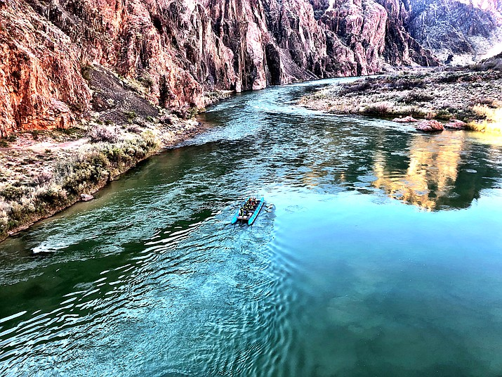 Grand Canyon speed runners race past the suspension bridge below Phantom Ranch during an attempt to set a new speed record by raft through the Grand Canyon. (Photo/Deirdre O'Connell)
