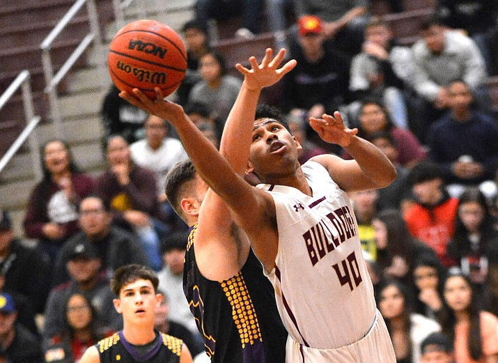 The Winslow Bulldogs easily defeated the Payson Longhorns, 83-46, Jan. 24. (Todd Roth/NHO)