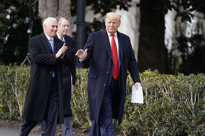 President Donald Trump arrives at an event with Vice President Mike Pence and U.S. Trade Representative Robert Lighthizer at the White House to sign a new North American trade agreement with Canada and Mexico, Wednesday, Jan. 29, 2020, in Washington. (Evan Vucci/AP)