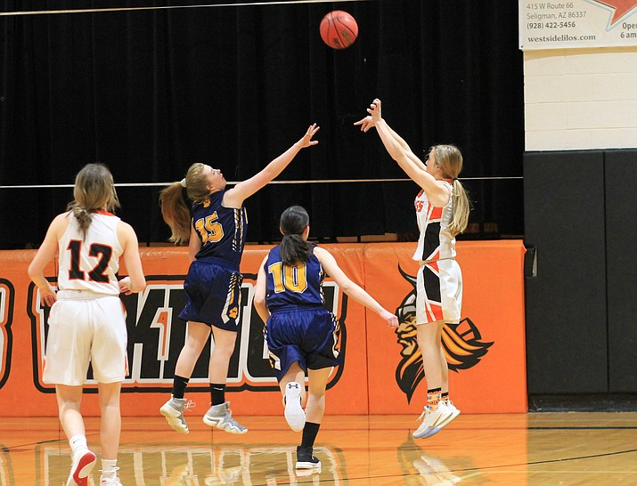 Viking Syndey Mortensen takes a shot over a Joseph City player Jan. 24. (Wendy Howell/WGCN)