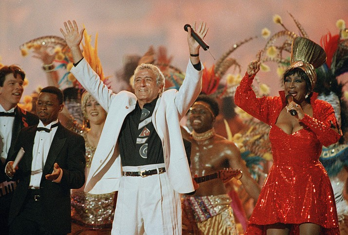 """In this Jan. 29. 1995 file photo, Singers Tony Bennett and Patti LaBelle entertain the crowd during halftime at Super Bowl XXIX at Miami's Joe Robbie Stadium. Regardless of your musical tastes, it seems the Super Bowl halftime show has gone there. From the sublime (Tony Bennett) to the ridiculous (Janet Jackson's """"uncovering''), and from Michael Jackson's moonwalks to U2's majestic remembrance of the 9/11 victims, the halftime presentations have drawn nearly as much attention as the NFL championship game itself.(AP Photo/Hans Deryk, File)"""