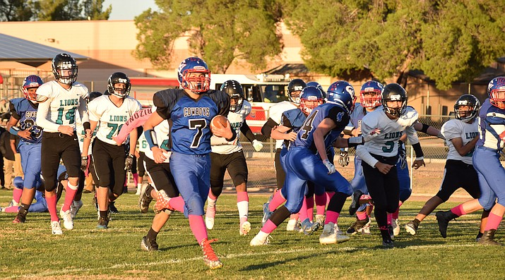 Camp Verde sophomore Jacob Oothoudt runs for a touchdown against Avondale St. John Paul II. Camp Verde is staying in the Verde Region while the Lions are headed to Agua Fria Region. VVN/James Kelley