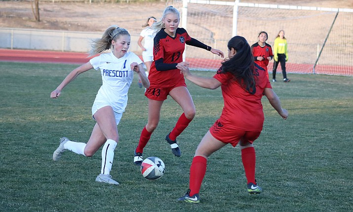 Lee Williams senior Tina Laegdhelm (13) and Adriana Leon try to stop a Prescott player Thursday during a 6-0 loss to the No. 1 ranked Lady Badgers. (Photo by Beau Bearden/Kingman Miner)