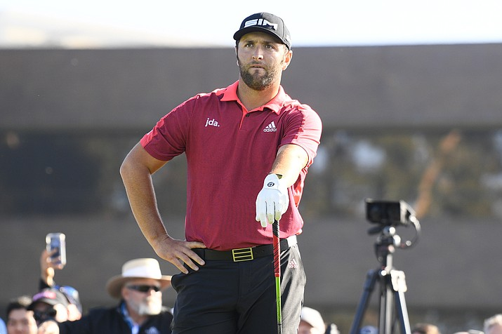 Jon Rahm tees off on the 14th hole on the South/North Course during the second round of the Farmers Insurance Open golf tournament at Torrey Pines Municipal Golf Course on January 24, 2020. (Photo by Brian Rothmuller/Icon Sportswire) (Icon Sportswire via AP Images)