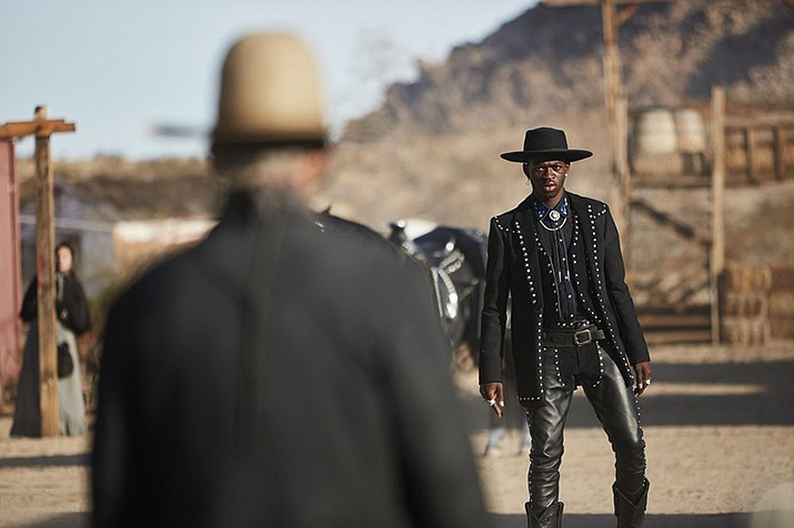 """This undated photo provided by Doritos shows Lil Nas X, right, and Sam Elliott in a scene from the company's 2020 Super Bowl NFL football spot. The snack chip is betting people will connect with """"Old Town Road,"""" the smash hit of the summer by Lil Nas X. (Doritos)"""
