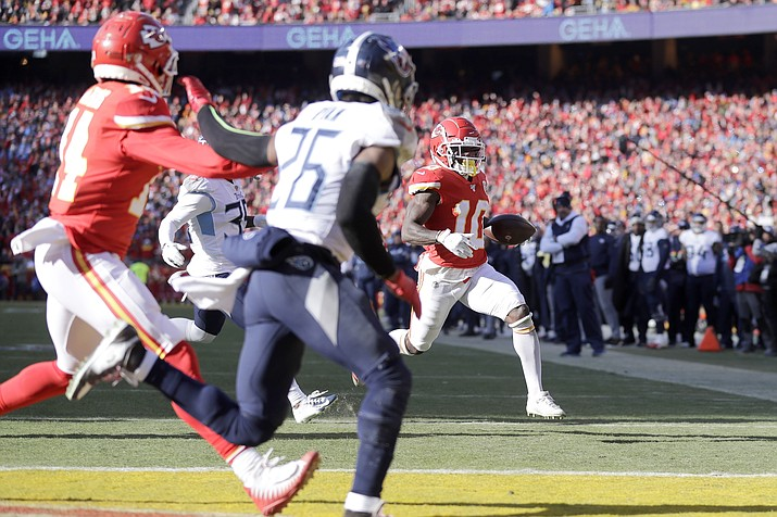 Kansas City Chiefs' Tyreek Hill (10) runs for a touchdown during the first half of the NFL AFC Championship football game against the Tennessee Titans Sunday, Jan. 19, 2020, in Kansas City, MO. (Jeff Roberson/AP)