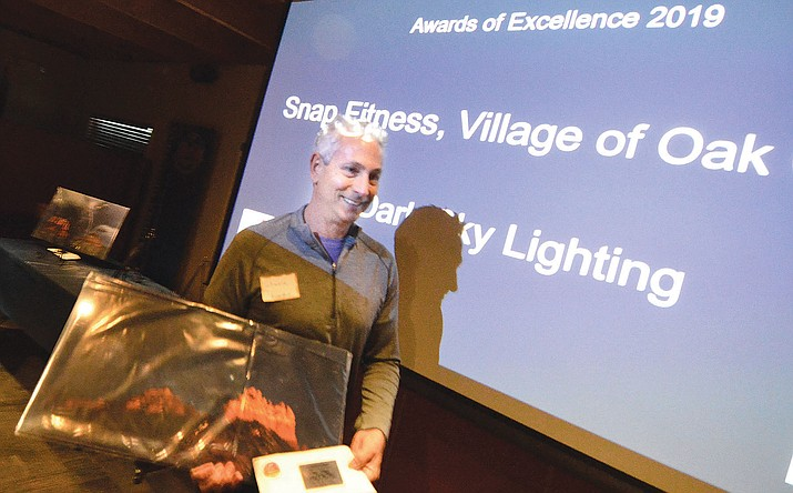 Steele Sacks of Snap Fitness in the Village of Oak Creek is awarded the KSB Award of Excellence for Dark Sky Lighting. VVN/Vyto Starinskas