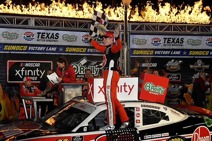 In this Nov. 2, 2019, file photo, Christopher Bell celebrates in Victory Lane after winning the NASCAR Xfinity Series auto race at Texas Motor Speedway in Fort Worth, Texas. NASCAR's season officially opens Sunday, Feb. 16, 2020, with the Daytona 500 at Daytona International Speedway. (Randy Holt/AP, file)