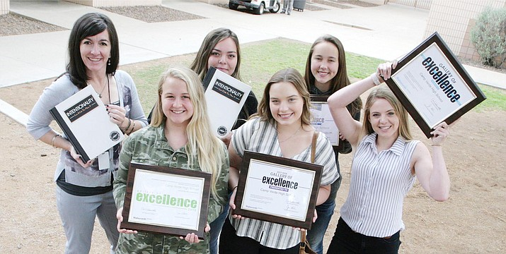 Camp Verde High School graphic arts teacher Tina Scott, far left, stands with her yearbook students in May 2019 after the school won for the fifth year in a row a Gallery of Excellence award for its yearbook. VVN/Bill Helm