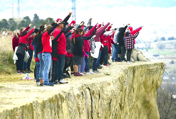 Hundreds form a line on the edge of the Billings Rimrocks for Line the Rims in Red event to honor missing and murdered indigenous people, in Billings, Montana in May 2019. (Larry Mayer/The Billings Gazette via AP)