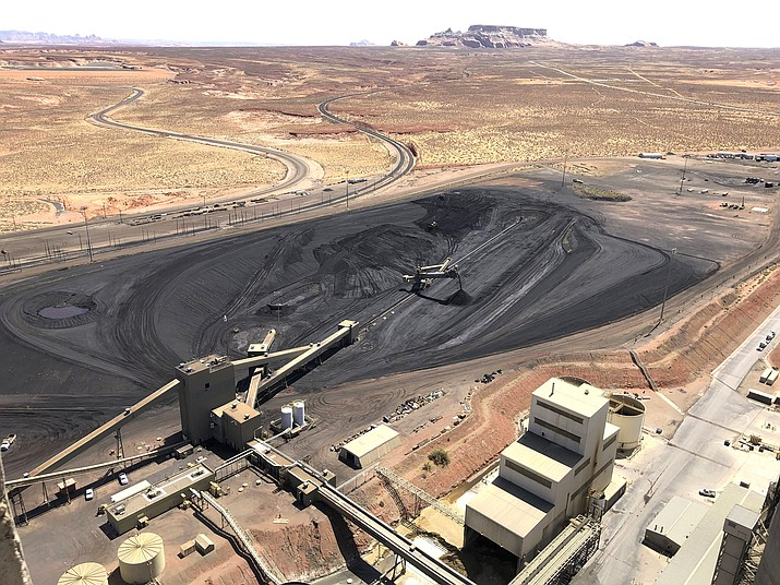 As the coal industry nears its end on the Navajo Nation, the tribe is looking to Arizona utilities that shared in the power generated on the reservation to help make up for the financial losses and environmental impacts. (AP Photo/Susan Montoya Bryan, File)