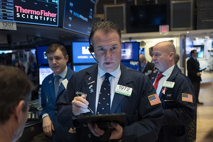 Stock trader Jonathan Corpina works at the New York Stock Exchange, Tuesday, Feb. 4, 2020. Stocks are opening broadly higher on Wall Street, following gains overseas. (Mark Lennihan/AP)