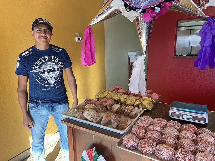 Javier Gonzalez displays fresh baked goods at Gonzalez Mini Market on Route 66 in Williams.  (Wendy Howell/WGCN)