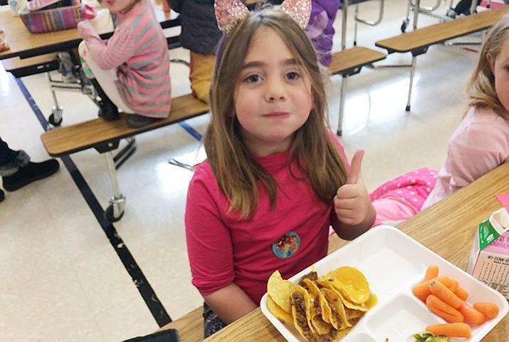 Kindergartner Kenzie Storman enjoyed her taste test, giving the veggie a thumbs up. (Nanci Hutson/ Courier)