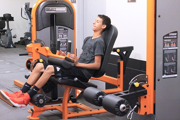 Xavier Shepherd works out in the Williams High School weight room. (Wendy Howell/WGCN)