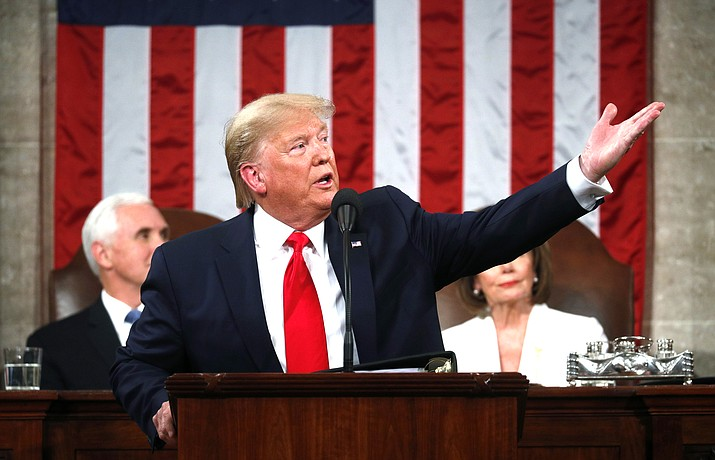 President Donald Trump delivers his State of the Union address to a joint session of Congress in the House Chamber on Capitol Hill in Washington, Feb. 4, as Vice President Mike Pence and Speaker Nancy Pelosi look on. (Leah Millis/Pool via AP)
