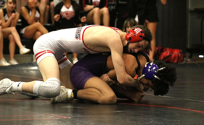 Lee Williams senior Zack Dixon, top, works a move against his Lake Havasu opponent Wednesday during a four-team dual meet. Dixon later tallied a pin and joined John Chandler and Christian Marzo with a perfect 3-0 day. (Photo by Beau Bearden/Kingman Miner)