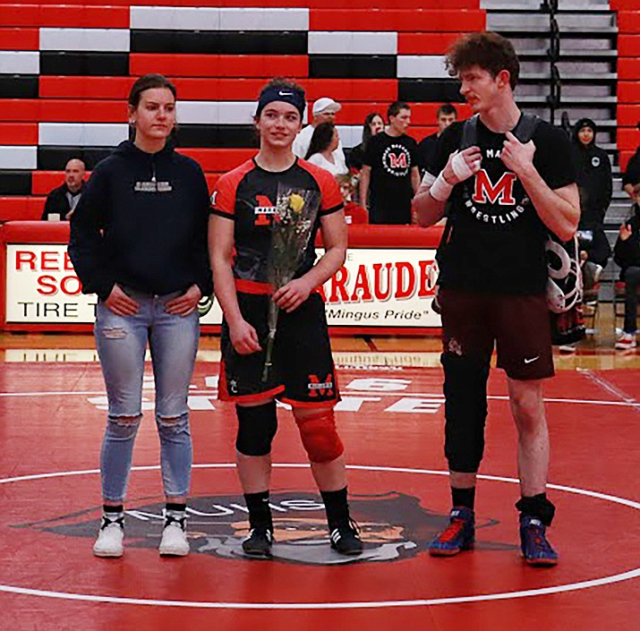 Mingus senior Zoey Arwine (center) won the Sectcion IV championship for 160 pounds in her first season wrestling. Photo courtesy Justin Wimer