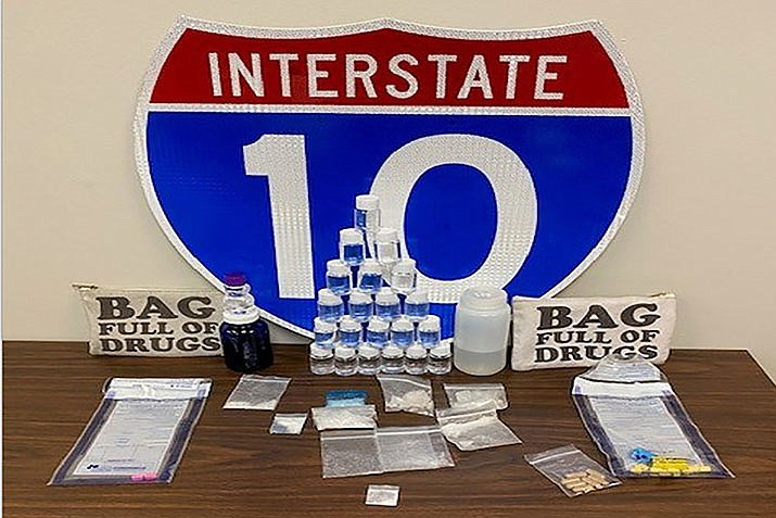 In this photo made available by the Florida Highway patrol shows confiscated drugs following the arrest of two men Tuesday, Feb. 4, 2020, Santa Rosa County, Fla. Authorities confiscated methamphetamine, cocaine and fentanyl. (Florida Highway Patrol photo)