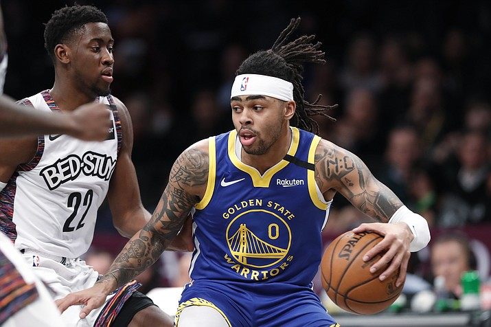 Golden State Warriors guard D'Angelo Russell (0) drives next to Brooklyn Nets guard Caris LeVert (22) during the first half of a game Wednesday, Feb. 5, 2020, in New York. (Kathy Willens/AP)