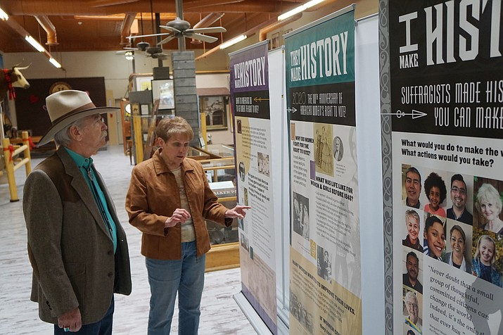 Dennis Gallagher of the Prescott Western Heritage Foundation and Arlene Bright, former state president of the Questers organization, discuss the six-panel traveling exhibit about the 100th anniversary of Women's Suffrage that is currently on display at the downtown Prescott Western Heritage Center. (Cindy Barks/Courier)