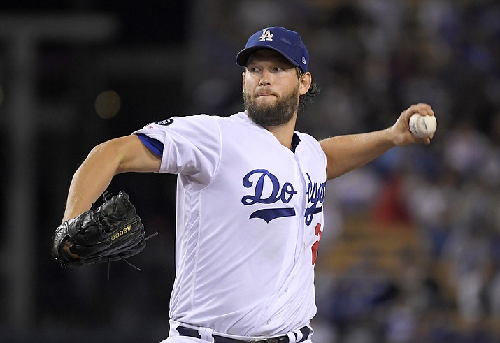 This Sept. 20, 2019 file photo shows Los Angeles Dodgers starting pitcher Clayton Kershaw pitching to the Colorado Rockies baseball team in Los Angeles. In what's become a familiar refrain, the Dodgers arrive at camp still looking for their first World Series championship since 1988. After losing in two straight World Series, they were ousted by Washington in five games in the NL Division Series last fall. The team had a quiet offseason.(Mark J. Terrill/AP, file)