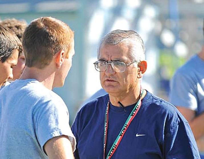 Prescott High School head football Coach Steve Moran talks with senior Colin Scott, 17, during a practice. (Courier file)