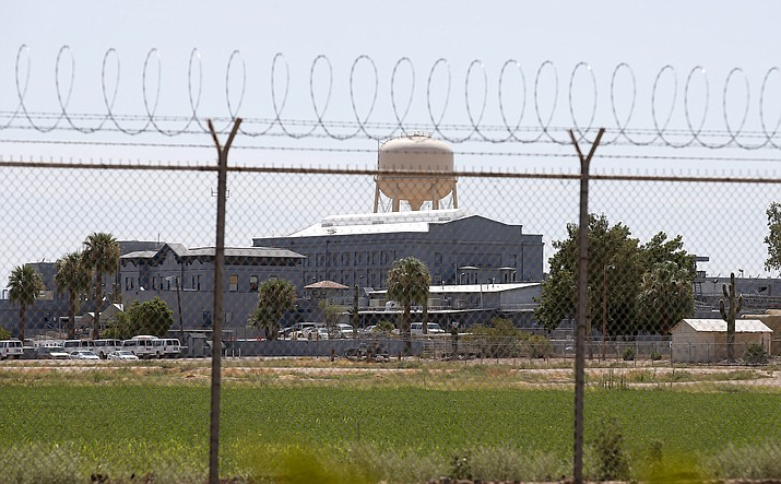 A Wednesday, July 23, 2014 photo shows the Florence State Prison in Florence, Ariz. Most of Arizona's 15 counties say their jails wouldn't be able to accommodate state inmates who'd no longer be housed at an aging state prison in Florence that Gov. Doug Ducey wants to close. (Ross D. Franklin/AP, File)