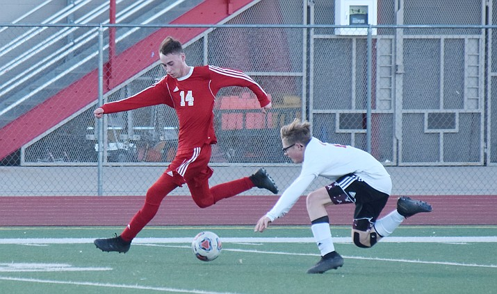 Mingus senior Dustin Bell dribbles past a Volunteer during the Marauders' 3-1 win over Lee Williams at home on Friday night. VVN/James Kelley